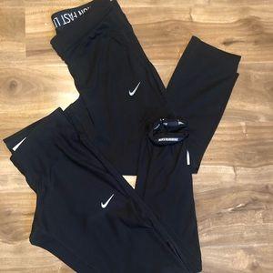 Two Nike Dri-Fit leggings